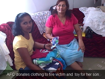 afc-donates-clothing-to-fire-victim